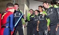 The Seattle Sounders are grateful as they meet Electron Boy, aka Erik Martin, who has freed them from their Qwest Field locker room Thursday. The Make-A-Wish Foundation arranged the adventure